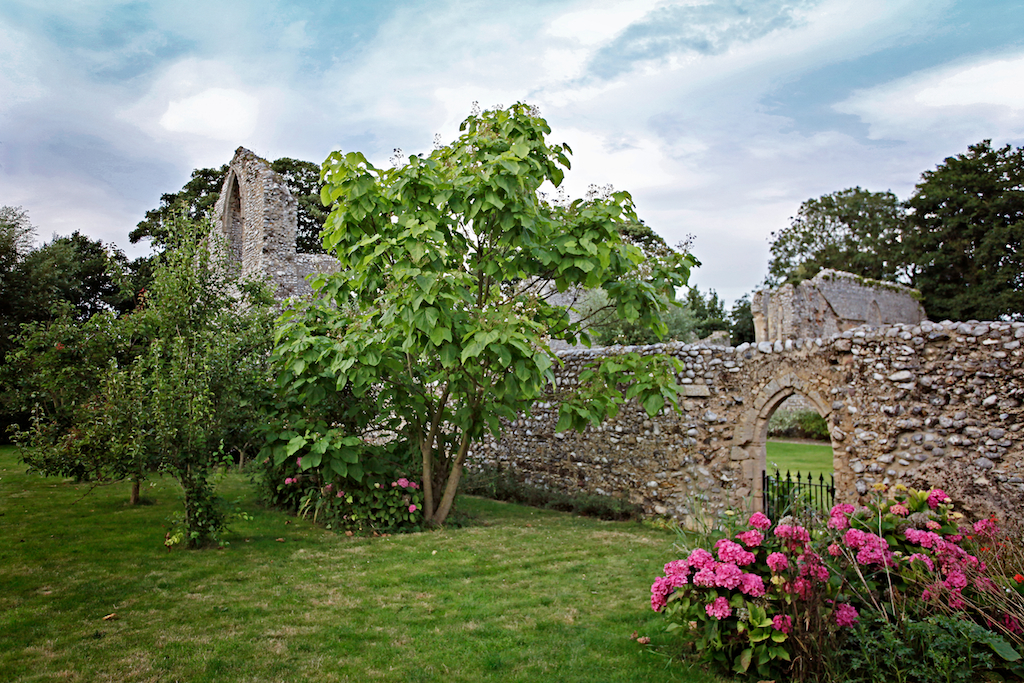 The cloisters gardens at Abbey Farm Cottages